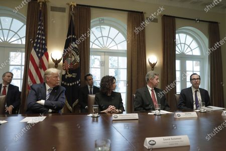Stock Picture of (L-R) U.S. President Donald J. Trump (L) meets with bankers including President and CEO of Independent Community Bankers of America Rebeca Romero Rainey, Chairman and CEO of Truist Financial Corporation Kelly King and US Secretary of Treasury Steven Mnuchin on COVID-19 coronavirus response at the White House in Washington, D.C., USA, 11 March 2020.