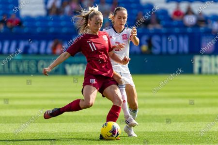 England's Toni Duggan prepares to kick the ball as Spain's Ainhoa Moraza defends during the first half of a SheBelieves Cup soccer match, in Frisco, Texas