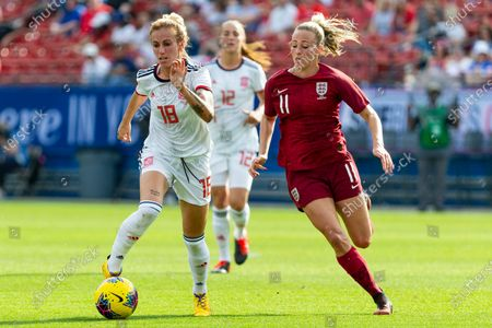 Spain's Angela Sosa controls the ball as England's Toni Duggan pursues during the first half of a SheBelieves Cup soccer match, in Frisco, Texas