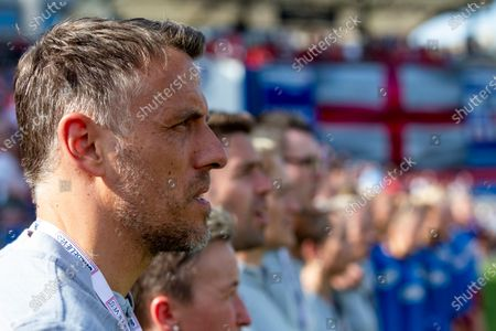 Stock Photo of England's manager Phil Neville looks on during the playing of his teams national anthem before a SheBelieves Cup soccer match against Spain, in Frisco, Texas