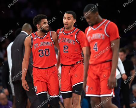 St. John's Red Storm guards LJ Figueroa (30), Julian Champagnie (2) and Greg Williams Jr. (4) during first round Big East Tournament play at Madison Square Garden in New York City. St Johns defeated Georgetown 75-62