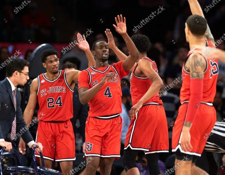 St. John's Red Storm guards Nick Rutherford (24) and Greg Williams Jr. (4) during a timeout during first round Big East Tournament play at Madison Square Garden in New York City. St Johns defeated Georgetown 75-62