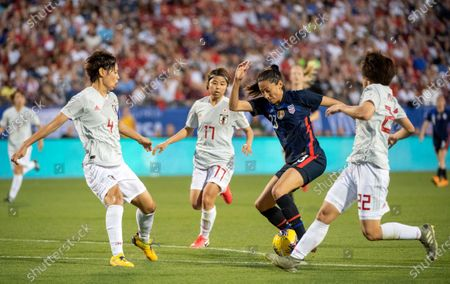 United States forward Christen Press (23) maneuvers past Japan's Saki Kumagai (4), Narumi Miura (17) and Mayo Doko (22) during the first half of a SheBelieves Cup women's soccer match, at Toyota Stadium in Frisco, Texas
