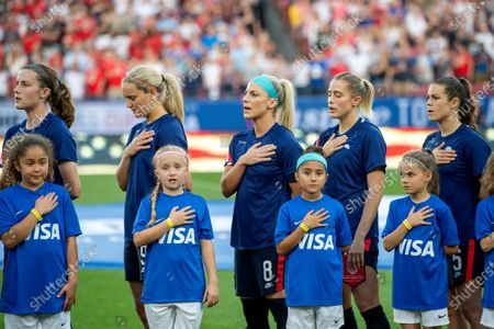 United States players Tierna Davidson, Lindsey Horan, Julie Ertz, Abby Dahlkemper, and Kelley O'Hara stand with their jerseys turned inside out during the playing of the national anthem before a SheBelieves Cup women's soccer match against Japan, at Toyota Stadium in Frisco, Texas