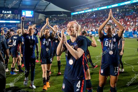 Defender Becky Sauerbrunn (4), forward Lynn Williams (13) and teammates acknowledge fans after a 3-1 win over Japan in a SheBelieves Cup soccer match, in Frisco, Texas