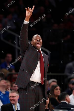 Georgetown coach Patrick Ewing gestures to his players during the second half of the team's NCAA college basketball game against St. John's in the first round of the Big East men's tournament, in New York