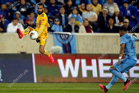 Tigres midfielder Jordan Sierra controls the ball in front of New York City FC defender Ronald Matarrita (22) during the first half in the first leg of a quarterfinal in the CONCACAF Champions League soccer tournament, in Harrison, N.J