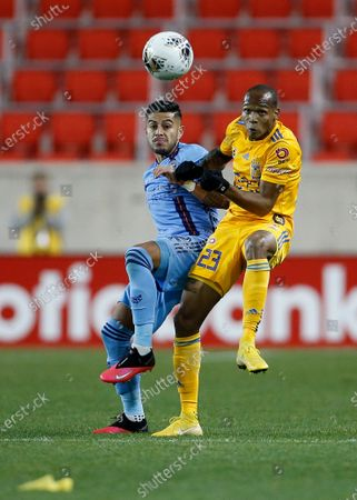 New York City FC defender Ronald Matarrita and Tigres forward Luis Quinones (23) vie for the ball during the second half in the first leg of a quarterfinal in the CONCACAF Champions League soccer tournament, in Harrison, N.J. Tigres won 1-0