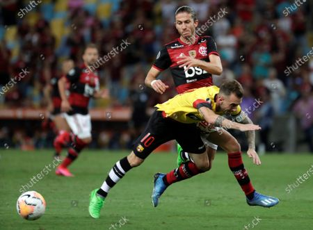 Stock Picture of Filipe Luis (rear) of Flamengo in action against Damian Diaz (front) of Barcelona SC during the Copa Libertadores group A soccer match between Flamengo and Barcelona SC, at Maracana Stadium in Rio de Janeiro, Brazil, 11 March 2020.