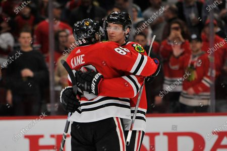 Chicago Blackhawks' Patrick Kane (88) celebrates with teammate Dominick Kubalik (8) of the Czech Republic, after defeating the San Jose Sharks 6-2 in an NHL hockey game, in Chicago
