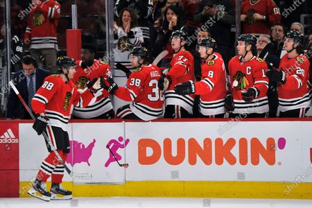 Chicago Blackhawks' Patrick Kane (88) celebrates with teammates on the bench after scoring a goal during the third period of an NHL hockey game against the San Jose Sharks, in Chicago. Chicago won 6-2