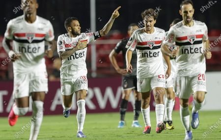 Daniel Alves of Brazil's Sao Paulo, second from left, celebrates with teammates after scoring his side's 2nd goal during a Copa Libertadores soccer match against Ecuador's Liga Deportiva Universitaria in Sao Paulo, Brazil