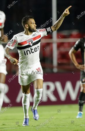 Daniel Alves of Brazil's Sao Paulo celebrates after scoring his side's 2nd goal during a Copa Libertadores soccer match against Ecuador's Liga Deportiva Universitaria in Sao Paulo, Brazil