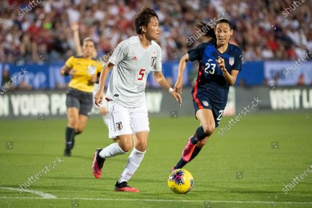 Japan defender Moeka Minami (5) dribbles past United States forward Christen Press (23) during the first half of a SheBelieves Cup women's soccer match, at Toyota Stadium in Frisco, Texas. The United States won 3-1