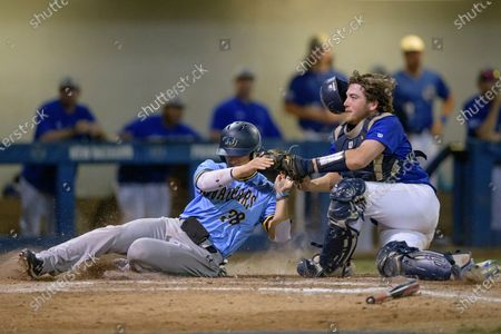 University of New Orleans catcher Jackson Murphy applies the tag to Southern University utility player Garrett Felix, but the ball went past the catcher's glove allowing Felix to score a run during an NCAA baseball game, in New Orleans. UNO announced today that it will continue to play games going forward but without fans and only allow players, essential staff, and members of the media, because of the COVID-19 Coronavirus. Mayor LaToya Cantrell declared a state of emergency because several people are being treated for illness from the virus in local hospitals