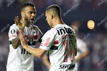Daniel Alves (L) and Antony (R) of Sao Paulo celebrate a goal during the Copa Libertadores group D soccer match between Sao Paulo and LDU Quito at the Morumbi Stadium in Sao Paulo, Brazil, 11 March 2020.