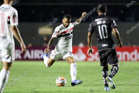 Daniel Alves (L) of Sao Paulo in action against Sornoza (R) of LDU Quito during the Copa Libertadores group D soccer match between Sao Paulo and LDU Quito at the Morumbi Stadium in Sao Paulo, Brazil, 11 March 2020.