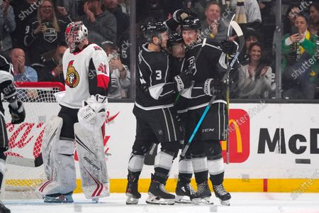 Stock Image of Los Angeles Kings center Gabriel Vilardi, right, is congratulated by Los Angeles Kings defenseman Matt Roy, second from left, and center Trevor Moore, second from right, after scoring as Ottawa Senators goaltender Craig Anderson stands at goal during the third period of an NHL hockey game, in Los Angeles. The Kings won 3-2