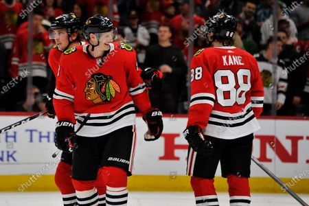 Chicago Blackhawks' Dominik Kubalik (8) of The Czech Republic, celebrates with teammate Patrick Kane (88) after defeating the San Jose Sharks 6-2 in an NHL hockey game, in Chicago