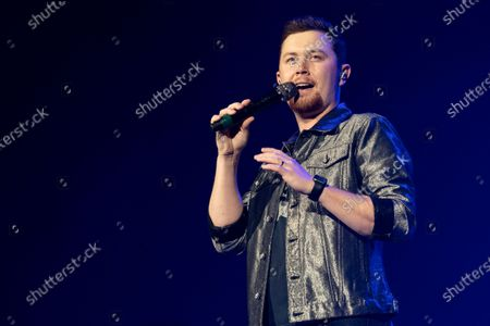 Stock Picture of Country musician Scotty McCreery performs at the Ryman Auditorium.
