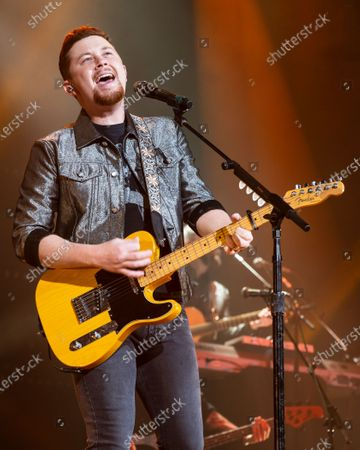 Country musician Scotty McCreery performs at the Ryman Auditorium.