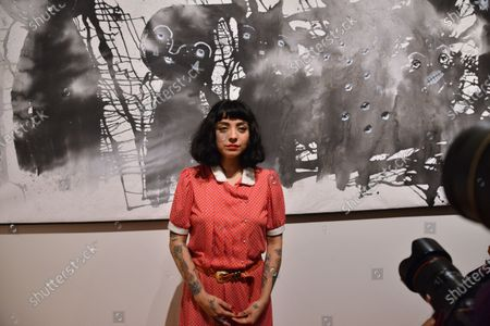 """Chilean activist and singer Mon Laferte poses for photos during the opening of her art exhibition """" Gestos """" are exhibited 70 paintings as part of Women's Time Festival for Equality at Museo de la Ciudad"""