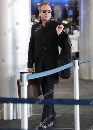 Editorial photo of Kiefer Sutherland out and about at LAX International Airport, Los Angeles, USA - 11 Mar 2020