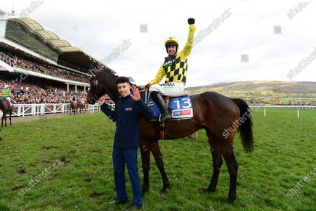 Cheltenham. SHISHKIN and Nico de Boinville greeted by groom Jaydon Lee after win for trainer Nicky Henderson and owners Joe & Marie Donnelly.