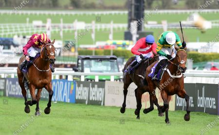 Cheltenham. RSA Insurance Novices' Chase (Grade 1) CHAMP and Barry Geraghty win for trainer Nicky Henderson and owner JP McManus from MINELLA INDO (left) and ALLAHO.