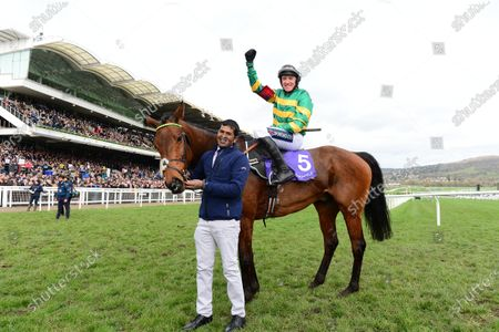 Cheltenham. RSA Insurance Novices' Chase (Grade 1) CHAMP and Barry Geraghty greeted by groom Satya Subramani after win for trainer Nicky Henderson and owner JP McManus.