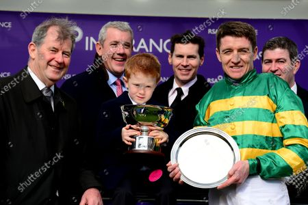 Cheltenham. RSA Insurance Novices' Chase (Grade 1) Presentation after CHAMP and Barry Geraghtywon for owner JP McManus with Archie McCoy (holding trophy), Cian Foley, John & Ciran McManus.
