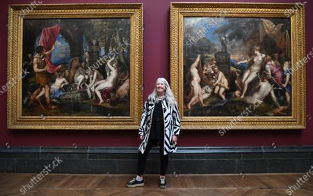 British historian and scholar Mary Beard  poses for photographers next to the paintings 'Diana and Actaeon' (L) and 'Diana and Callisto' (R), part of Titian's Poesie series of large scale Greek mythological paintings that feature in the 'Titian: Love, Desire, Death' exhibition, at the National Gallery in London, Britain, 12 March 2020. The exhibition reunites all six paintings in the series, from collections in Boston, Madrid, and London, for the first time in over four centuries.