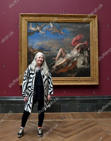 British historian and scholar Mary Beard poses for photographers next to the painting entitled 'The Rape of Europa', part of Titian's Poesie series of large scale Greek mythological paintings that feature in the 'Titian: Love, Desire, Death' exhibition, at the National Gallery in London, Britain, 12 March 2020. The exhibition reunites all six paintings in the series, from collections in Boston, Madrid, and London, for the first time in over four centuries.