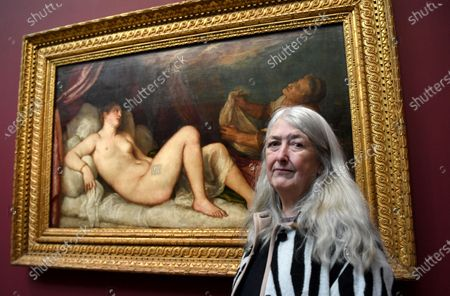 British historian and scholar Mary Beard  poses for photographers next to the painting 'Danae' part of Titian's Poesie series of large scale Greek mythological paintings that feature in the 'Titian: Love, Desire, Death' exhibition, at the National Gallery in London, Britain, 12 March 2020. The exhibition reunites all six paintings in the series, from collections in Boston, Madrid, and London, for the first time in over four centuries.