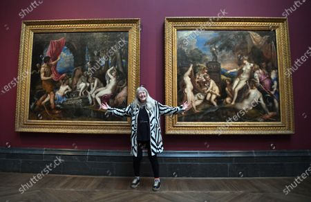 Stock Photo of British historian and scholar Mary Beard  poses for photographers next to the paintings 'Diana and Actaeon' (L) and 'Diana and Callisto' (R), part of Titian's Poesie series of large scale Greek mythological paintings that feature in the 'Titian: Love, Desire, Death' exhibition, at the National Gallery in London, Britain, 12 March 2020. The exhibition reunites all six paintings in the series, from collections in Boston, Madrid, and London, for the first time in over four centuries.