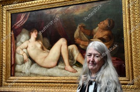 Stock Image of British historian and scholar Mary Beard  poses for photographers next to the painting 'Danae' part of Titian's Poesie series of large scale Greek mythological paintings that feature in the 'Titian: Love, Desire, Death' exhibition, at the National Gallery in London, Britain, 12 March 2020. The exhibition reunites all six paintings in the series, from collections in Boston, Madrid, and London, for the first time in over four centuries.