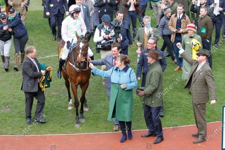 Rich Ricci greets Min after victory in the Ryanair Chase at Cheltenham.