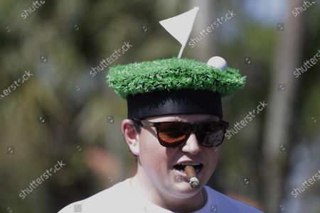 Golf fan Nick Walker, watches the action from the eight hole, during the first round of The Players Championship golf tournament, in Ponte Vedra Beach, Fla