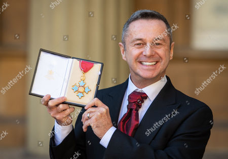 Choreographer Stephen Mear with his CBE medal, awarded at an investiture ceremony at Buckingham Palace