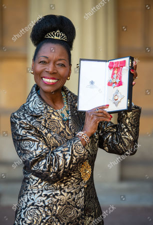 Stock Photo of Floella Benjamin with her Dame Commander medal, after being awarded her damehood at an investiture ceremony at Buckingham Palace