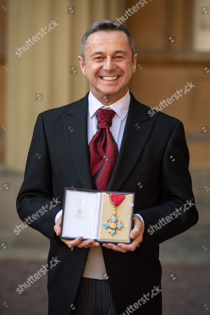 Stock Photo of Choreographer Stephen Mear with his CBE medal, awarded at an investiture ceremony at Buckingham Palace