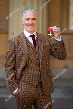 Gordon Buchanan with his MBE medal, awarded at an investiture ceremony at Buckingham Palace