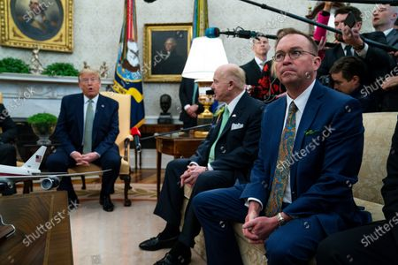 Stock Image of Former acting White House chief of staff Mick Mulvaney listens as President Donald Trump speaks during a meeting with Irish Prime Minister Leo Varadkar in the Oval Office of the White House, in Washington