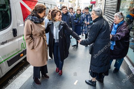Stock Photo of Former French Health Minister and La Republique En Marche (LREM) party's mayoral candidate for Paris Agnes Buzyn (L) and 9th district candidate Delphine Burkli (2-L) visit a shopping neighborhood as part of the election campaign in Paris, France, 12 March 2020. Buzyn, who belongs to the party ruling the national executive led by President Emmanuel Macron, replaced former candidate Benjamin Griveaux, who dropped out from the race on 14 February amid a sexual imagery-related scandal. The upcoming French municipal elections are scheduled for 15 and 22 March 2020, corresponding with the first and second rounds of voting, respectively.
