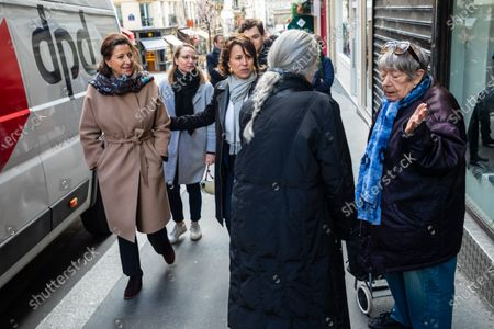 Former French Health Minister and La Republique En Marche (LREM) party's mayoral candidate for Paris Agnes Buzyn (L) visits a shopping neighborhood as part of the election campaign in Paris, France, 12 March 2020. Buzyn, who belongs to the party ruling the national executive led by President Emmanuel Macron, replaced former candidate Benjamin Griveaux, who dropped out from the race on 14 February amid a sexual imagery-related scandal. The upcoming French municipal elections are scheduled for 15 and 22 March 2020, corresponding with the first and second rounds of voting, respectively.