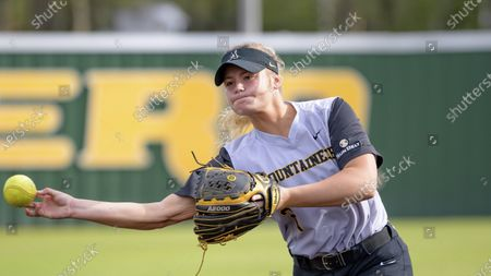 Stock Photo of Appalachian State pitcher Taylor Nichols throws during an NCAA softball game against Southeastern Louisiana, in Hammond, La
