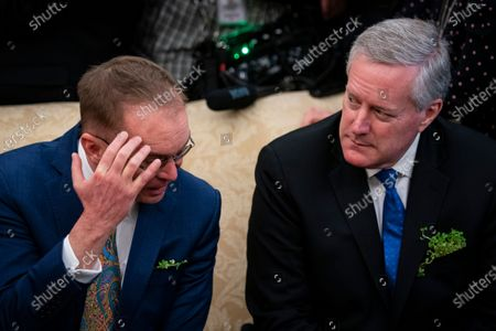 United States special envoy to Northern Ireland Mick Mulvaney, left, speaks with White House Chief of Staff Mark Meadows, right, as United States President Donald Trump, not pictured, speaks during a meeting with Taoiseach Leo Varadkar of Ireland in the Oval Office of the White House.