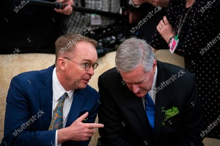 Stock Photo of United States special envoy to Northern Ireland Mick Mulvaney, left, speaks with White House Chief of Staff Mark Meadows, right, as United States President Donald Trump, not pictured, speaks during a meeting with Taoiseach Leo Varadkar of Ireland in the Oval Office of the White House.