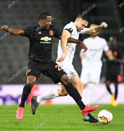 Manchester United's Odion Ighalo (L) in action against  LASK's James Holland (R) during the UEFA Europa League round of 16, first leg soccer match between LASK Linz and Manchester United in Linz, Austria, 12 March 2020.