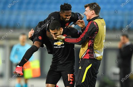 Manchester United's Andreas Pereira (C) celebrates with teammates after scoring the 5-0 lead during the UEFA Europa League round of 16, first leg soccer match between LASK Linz and Manchester United in Linz, Austria, 12 March 2020.
